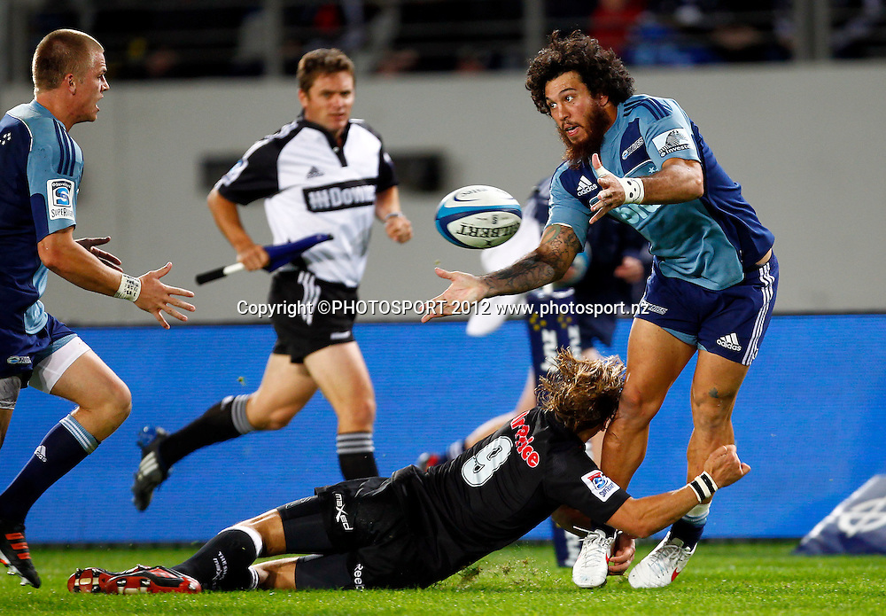 Blues rene Ranger offloads to Gareth Anscombe during the Super Rugby game between The Blues and The Sharks at Eden Park, Auckland New Zealand, Friday 13 April 2012. Photo: Simon Watts / photosport.co.nz
