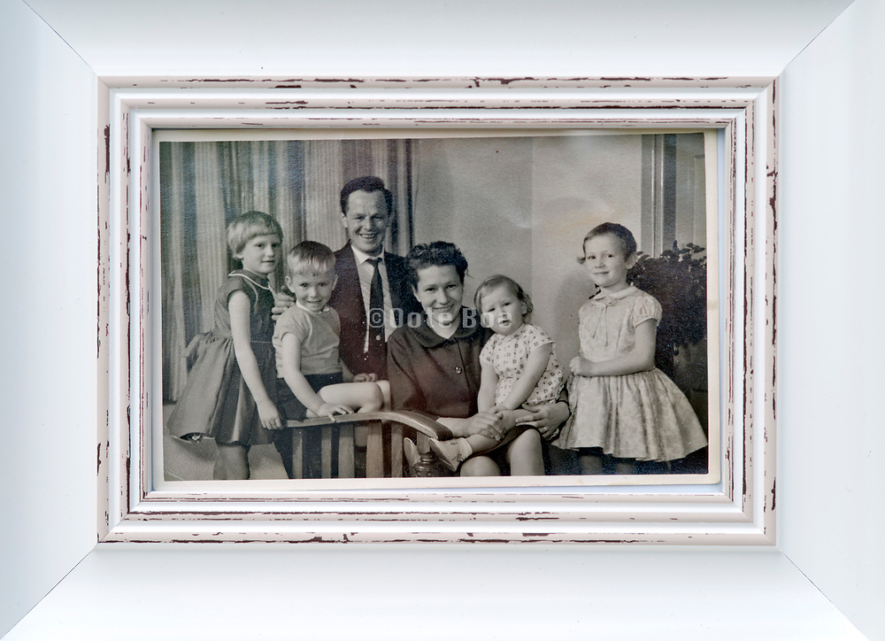framed 1960s happy family group photograph