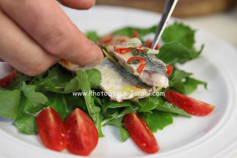 Roquette and tomato Salad and fried mackerel