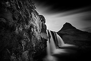 Kirkjufellsfoss waterfall and Kirkjufell mountain, Iceland, long exposure, B and W.