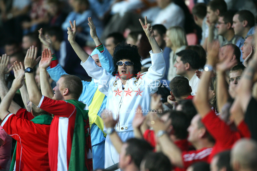 RIGA, LATVIA - WEDNESDAY AUGUST 18th 2004: Wales' fans dressed as Elvis and Thunderbirds enjoy their side's 2-0 victory over Latvia during the International Friendly match at the Skonto Stadium, Riga. (Photo by David Rawcliffe/Propaganda)