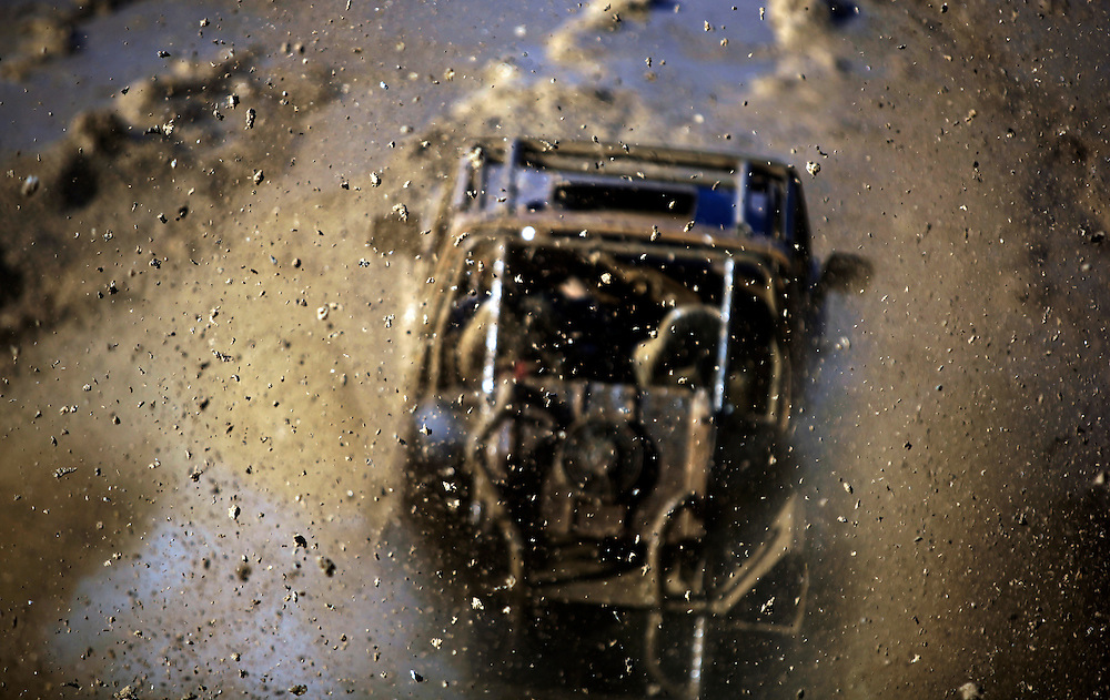 Mud is sprayed into the air from a truck at the Redneck Yacht Club in Punta Gorda, Fla. Photo by: Greg Kahn