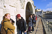 Sur le Pont d'Avignon... (Pont St-Bénézet). Tourists listening to a guided tour via handsets.