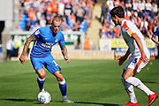 Peterborough United midfielder Joe Ward (15) on the ball during the EFL Sky Bet League 1 match between Peterborough United and Luton Town at London Road, Peterborough, England on 18 August 2018.