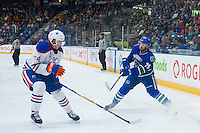 PENTICTON, CANADA - SEPTEMBER 16: Ethan Bear #74 of Edmonton Oilers stick checks Danny Moynihan #79 of Vancouver Canucks on September 16, 2016 at the South Okanagan Event Centre in Penticton, British Columbia, Canada.  (Photo by Marissa Baecker/Shoot the Breeze)  *** Local Caption *** Ethan Bear; Danny Moynihan;