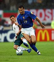 Gianluca Zambrotta Italy / Zdravkov Lazarov Bulgaria<br /> Italy EURO 2004<br /> Italy V Bulgaria 22/06/04 EURO 2004 PORTUGAL<br /> Photo Robin Parker Digitaslport