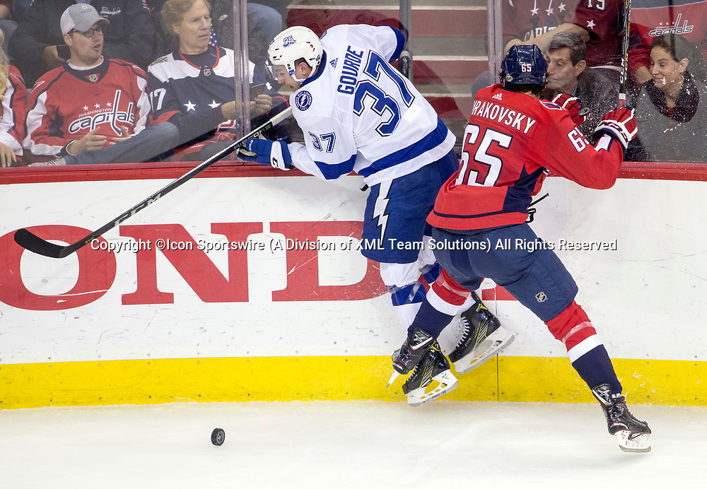 WASHINGTON, DC - MAY 21: Washington Capitals left wing Andre Burakovsky (65) checks Tampa Bay Lightning center Yanni Gourde (37) into the boards during game 6 of the NHL Eastern Conference  Finals between the Washington Capitals and the Tampa Bay Lightning, on May 21, 2018, at Capital One Arena, in Washington D.C. The Caps defeated the Lightning 3-0<br /> (Photo by Tony Quinn/Icon Sportswire)