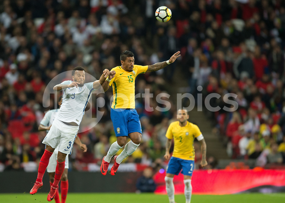 Ryan Bertrand of England battles with Paulinho of Brazil during the International Friendly match between England and Brazil at Wembley Stadium, London, England on 14 November 2017. Photo by Vince Mignott.