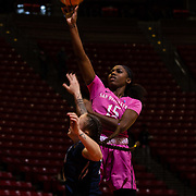 10 February 2018: The San Diego State Aztecs women's basketball team hosts Nevada on Play4Kay day at Viejas Arena. San Diego State Aztecs guard McKynzie Fort (15) attempts a running jump shot in the paint over a Nevada Wolf Pack defender in the first half. <br /> More game action at www.sdsuaztecphotos.com