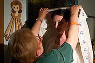 Sant'Ilario (PZ), 05-06-2010 ITALY - Due ragazzi americani, Josh Riley e Courtney Bleiler, hanno deciso di sposarsi nel piccolo borgo lucano di Sant'Ilario. La bisnonna materna  dello sposo, Maria Donata Telesca, emigrata negli Usa nel 1906,  era originaria di Sant'Ilario. Il matrimonio si è celebrato secondo gli usi di una volta. Un matrimonio d'altri tempi con costumi originali dell'epoca..Nella Foto: Le donne del paese vestono la sposa Courtney Bleiler con un costume tradizionale del matrimonio di circa 80 anni..Photo by Giovanni Marino/OTNPhotos . Obligatory Credit