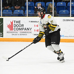 TRENTON, ON  - MAY 2,  2017: Canadian Junior Hockey League, Central Canadian Jr. &quot;A&quot; Championship. The Dudley Hewitt Cup. Game 2 between Powassan Voodoos and the Trenton Golden Hawks. Ryan Bazzana #21 of the Powassan Voodoos skates with the puck during the second period.<br /> (Photo by Andy Corneau / OJHL Images)