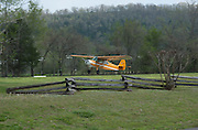 Aeronica Champ airplane landing at Gaston's White River Resort near Flippin, Arkasnsas.