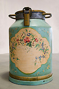 Close-up of a decorated old style milk canister