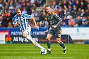 James Maddison of Leicester City (10) in action during the Premier League match between Huddersfield Town and Leicester City at the John Smiths Stadium, Huddersfield, England on 6 April 2019.