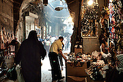 A woman walks towards one of the gates of Aleppo's souq