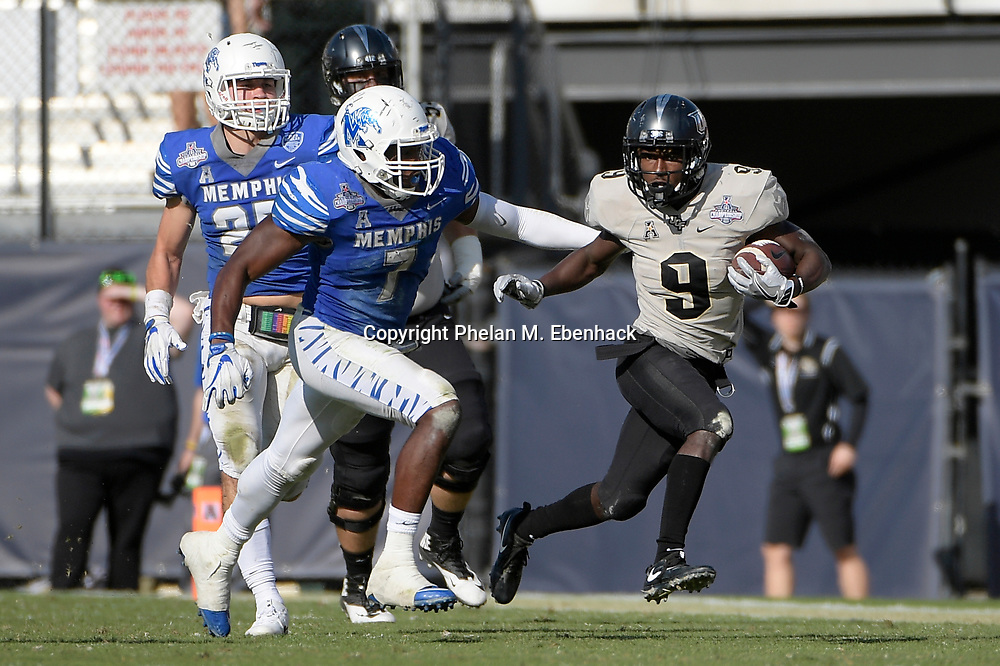 Central Florida running back Adrian Killins Jr. (9) returns a punt in front of Memphis linebacker Curtis Akins (7) during the second half of the American Athletic Conference championship NCAA college football game Saturday, Dec. 2, 2017, in Orlando, Fla. Central Florida won 62-55. (Photo by Phelan M. Ebenhack)