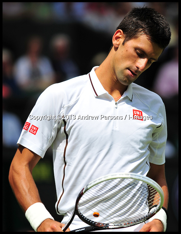Novak Djokovic v Florian Mayer on Centre Court at the Wimbledon Tennis Championships.<br /> Tuesday, 25th June 2013<br /> Picture by Andrew Parsons / i-Images