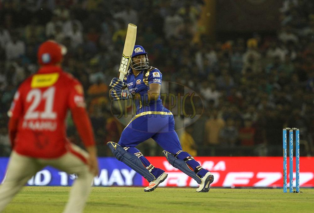 Mumbai Indians player Kieron Pollard plays a shot during match 21 of the Vivo Indian Premier League ( IPL ) 2016 between the Kings XI Punjab and the Mumbai Indians held at the IS Bindra Stadium, Mohali, India on the 25th April 2016<br /> <br /> Photo by Vipin Pawar / IPL/ SPORTZPICS