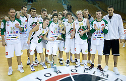 Team of Olimpija (from L Djordjevic, Golubovic, Bavcic, Vidmar, Klobucar, Ozbolt, Kikowski, Slokar, Sutulovic, Walsh, Becirovic and Nemanja) with a cup at Superpokal basketball match between KK Union Olimpija and Elektra Esotech, on September 27, 2009, in Arena Tivoli, Ljubljana, Slovenia. Olimpija won 95:62.  (Photo by Vid Ponikvar / Sportida)