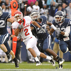 Oct 31, 2009; East Hartford, CT, USA; Rutgers wide receiver Tim Brown (2) outruns Connecticut defenders on his way to the game winning touchdown with 11 seconds left during second half Big East NCAA football action in Rutgers' 28-24 victory over Connecticut at Rentschler Field.