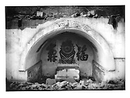 After demolition: Same Buddhist temple completely flattened except for this small  grotto ready for the inundation from the Three Gorges (of the Yangtze River) Dam hundreds of kilometers downstream, Fengdu, China.