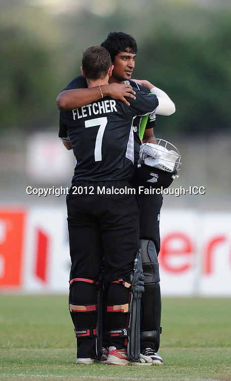 TOWNSVILLE, AUSTRALIA - AUGUST 20:  Cameron Fletcher of New Zealand congratulates Ish Sodhi (R) after New Zealand defeated the West Indies during the ICC U19 Cricket World Cup 2012 Quarter Final match between New Zealand and the West Indies at Endeavour Park on August 20, 2012 in Townsville, Australia.  (Photo by Malcolm Fairclough-ICC/Getty Images)