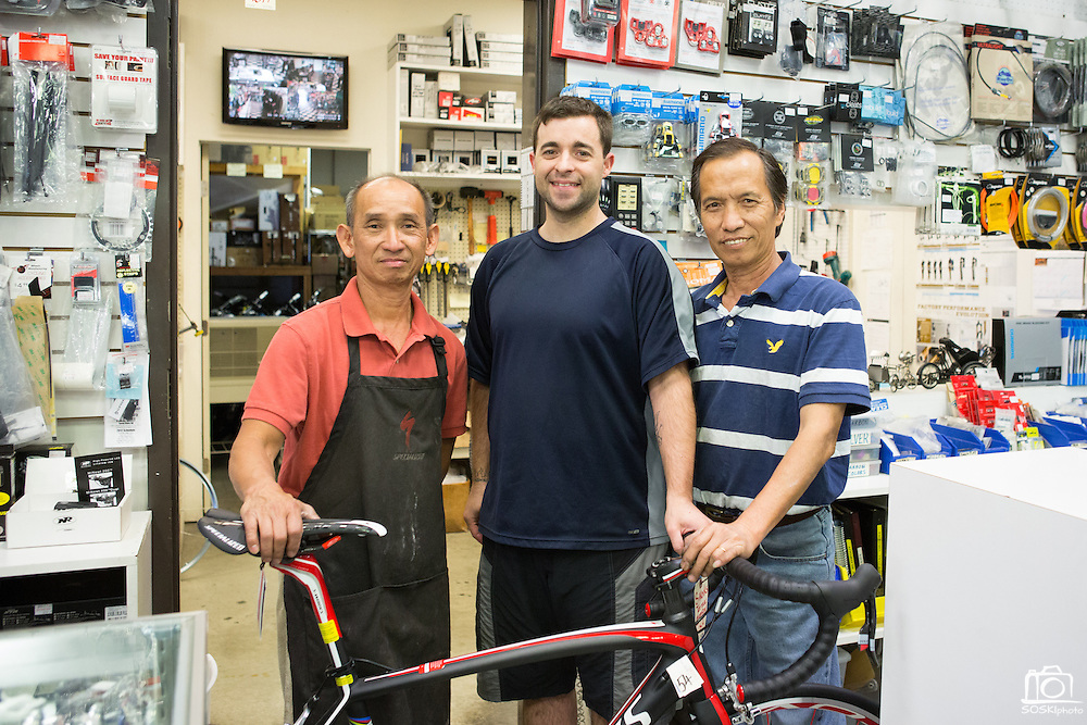 Jason Tran (left), Francis Landice (center), and Peter Nugyen (right) of Sun Bike Shop in Milpitas, Calif., pose for a photo on Sept. 18, 2012.  Photo by Stan Olszewski/SOSKIphoto.