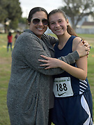Nov 1, 2017; Long Beach, CA, USA; Brittany Murray (left) poses with daughter Phoebe Murray of Millikan during the Moore League cross country finals at Heartwell Park.