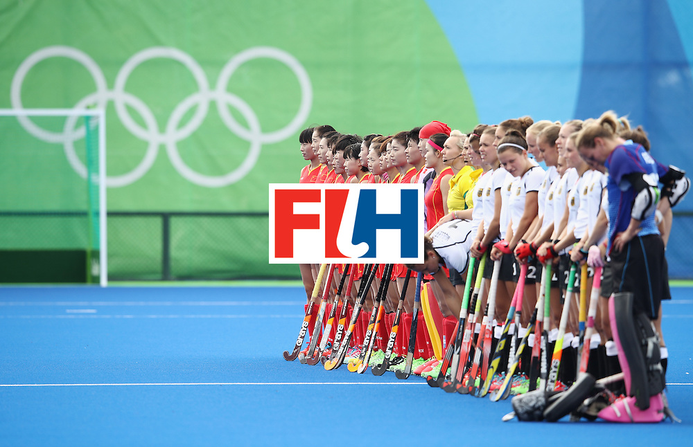RIO DE JANEIRO, BRAZIL - AUGUST 07:   Chinaand Germany line up for the anthems during the women's pool A match between China and Germany on Day 2 of the Rio 2016 Olympic Games at the Olympic Hockey Centre on August 7, 2016 in Rio de Janeiro, Brazil.  (Photo by Mark Kolbe/Getty Images)