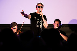 "© Licensed to London News Pictures . 14/08/2015 . Manchester , UK . Poet MIKE GARRY performs single "" St Anthony : an ode to Anthony H Wilson "" , written by Garry and composer Joe Duddell , with the Cassia String Quartet . A tribute to Tony Wilson at Old Granada Studios . Photo credit : Joel Goodman/LNP"