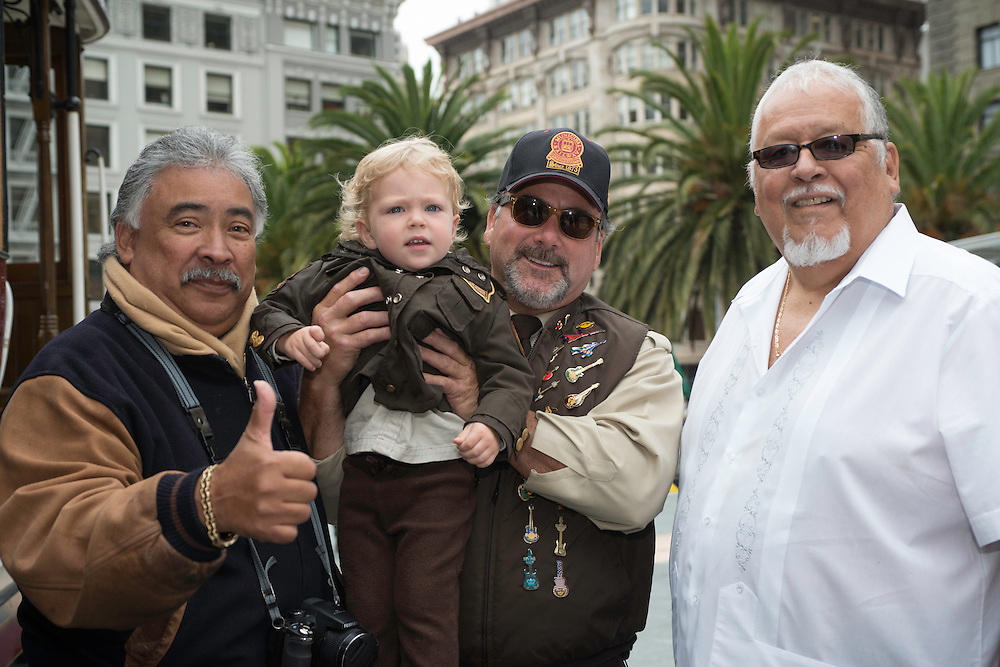 The past, present and future bell ringers pose in front of Cable Car 62 before the 50th Cable Car Bell Ringing Competition in San Francisco's Union Square | July 11, 2013