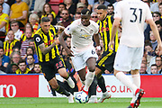 Manchester United Midfielder Paul Pogba battles with Watford defender Jose Holebas (25)  during the Premier League match between Watford and Manchester United at Vicarage Road, Watford, England on 15 September 2018.