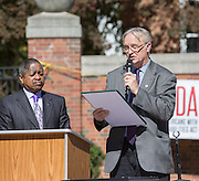 Athens Mayor Paul Wiehl, right, reads the first half of the resolution to recommit to continue advocacy of the ADA while Ohio University President Roderick McDavis, left, waits to read the second half during the ADA25 Kickoff Event on Ohio 6, 2015 at Ohio University's Howard Park. Photo by Emily Matthews