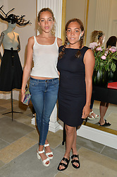 Left to right, PHOEBE COLLINGS JAMES and MIQUITA OLIVER at the launch of the new Marina Rinaldi flagship store at 5 Albemarle Street, London on 3rd July 2014.