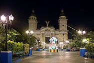 Cespedes Park and the Metropolitan Cathedral at night during Carnival, Santiago de Cuba, Cuba.