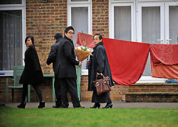© Licensed to London News Pictures. 19/12/2011, London, UK. People arrive with flowers at the back entrance to the building. The North Korean embassy in West London. Kim Jong Il's death on Saturday, aged 69, was announced last night in a special broadcast by state TV from the North Korean capital. Photo credit: Stephen Simpson/LNP