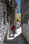 Woman walking Marpha stone streets (Nepal)