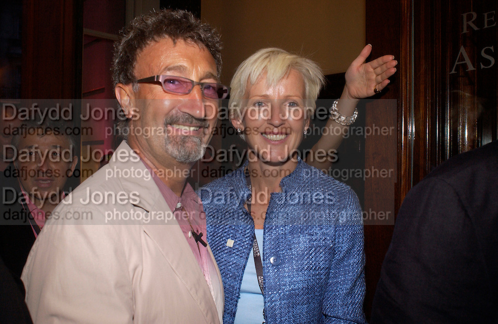 Mr. and Mrs. Eddie Jordan, Party at Fifty, St. James St. following the Formula  1 showcase where drivers raced down Regent St. in central London. 6 July 2004. SUPPLIED FOR ONE-TIME USE ONLY-DO NOT ARCHIVE. © Copyright Photograph by Dafydd Jones 66 Stockwell Park Rd. London SW9 0DA Tel 020 7733 0108 www.dafjones.com