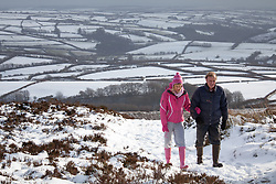 © Licensed to London News Pictures. 14/01/2015. Wheddon Cross, Devon, UK. A couple walking on Dunkery Hill in Exmoor National Park, Devon this morning, 14th January 2015. Snow has fallen overnight across many parts of England, causing travel disruption in some areas.  Photo credit : Rob Arnold/LNP