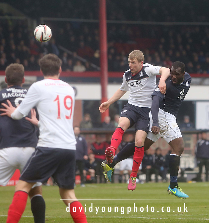 Christian Nade beats Stephen Kingsley to get a header in on goal - Dundee  v Falkirk - SPFL Championship at Dens Park<br /> <br />  - &copy; David Young - www.davidyoungphoto.co.uk - email: davidyoungphoto@gmail.com