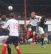 Christian Nade beats Stephen Kingsley to get a header in on goal - Dundee  v Falkirk - SPFL Championship at Dens Park<br /> <br />  - &copy; David Young - www.davidyoungphoto.co.uk - email: davidyoungphoto@gmail.com