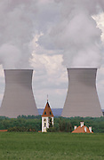 Nuclear energy: Nuclear Power Plant cooling towers flanking the village church steeple, Offingen, Germany. (1987).