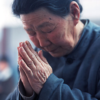 LIUJIAZHUANG VILLAGE, 8 APRIL 2001: a 78 year old women prays on Palm Sunday in an official church.China cut relations with the Vatican in the early fifites and since then, established a Patriotic catholic Church that's controlled by Chinese authorities.<br />