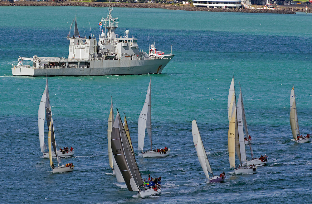 HMNZS Wellington watches the annual Coastal Classic Yacht Race depart for the Bay of Islands, Auckland, New Zealand, Friday, October 25, 2013.  Credit:SNPA / David Rowland