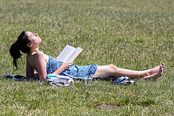 © Licensed to London News Pictures. 22/06/2020. London, UK. A woman takes a break from reading a book in Finsbury Park, north London on a warm and sunny day in the capital. According to the Met Office, the temperatures are forecast to reach between 31 and 33 degrees celsius in the south-east of England later this week. Photo credit: Dinendra Haria/LNP