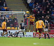 23rd December 2017, Fir Park, Motherwell, Dundee; Scottish Premier League football, Motherwell versus Dundee; Dundee goalkeeper Elliott Parish clutches a high ball under pressure from Motherwell's Charles Dunne