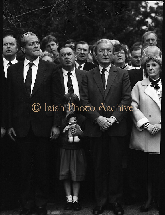 Annual Wolfe Tone Commemoration.  (R65)..1987..11.10.1987..10.11.1987..11th October 1987..The annual Fianna Fáil Wolfe Tone commemoration was held at Bodenstown today, the keynote oration was given by An Taoiseach, Charles Haughey TD...A young girl and her doll are pictured standing between An Tanaiste, Brian Lenihan and An Taoiseach ,Charles Haughey at the playing of the National Anthem.