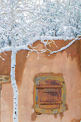 detail of a snow covered home in Santa Fe, New Mexico