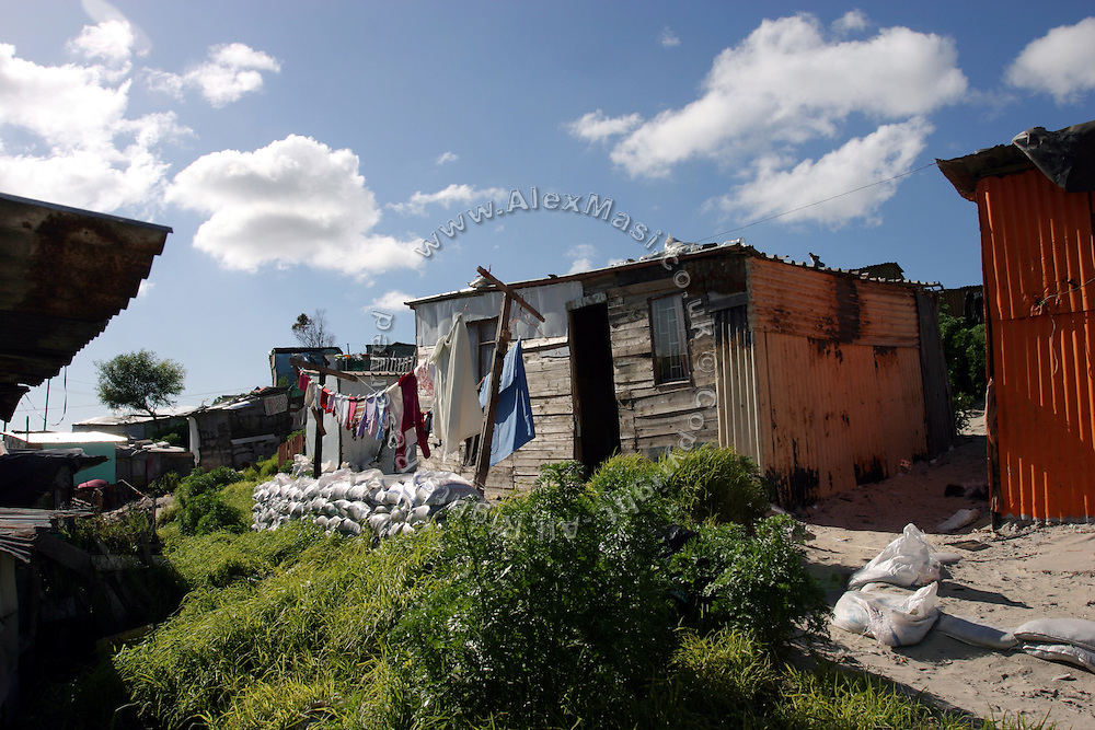Houses are build in corrugated iron and wood in Khayelitsha township in Cape Town, where over a million people live in the extreme poverty..