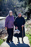 Two sisters living in the small Crete mountain village of Rodovani. Androniki (72, left) with her sister Panagiota (86).